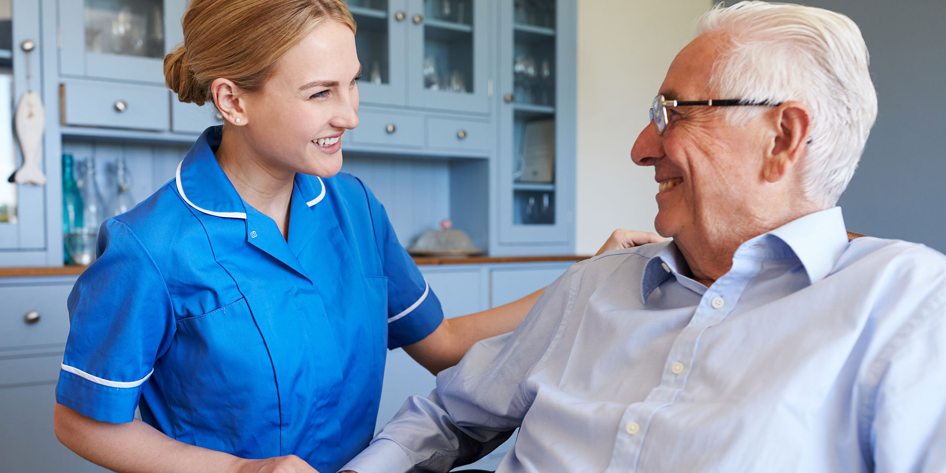 Nurse with pensioner. We supply nursing and healthcare staff for temp or permanent positions across the UK